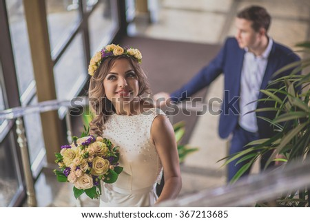 Bride smiling staircase groom hotel - stock photo