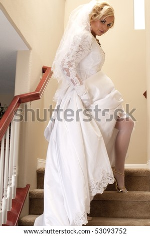 Bride Striptease Series #3 - stock photo