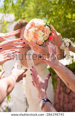 Bride throwing bouquet - stock photo