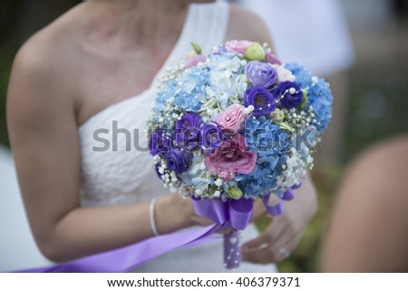Bride throwing flowers blurred Texture background