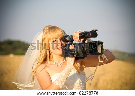 bride video operator with HDV camcorder - stock photo