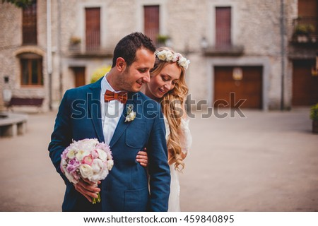 bride  whispers something in your ear groom - stock photo