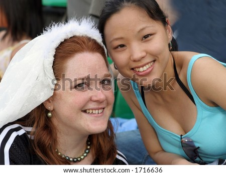 Bride with a friend on her wedding day - stock photo