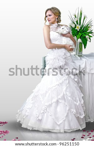 Bride with a rabbit on a white background - stock photo