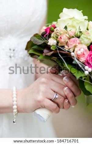 Bride with bouquet and ring - stock photo