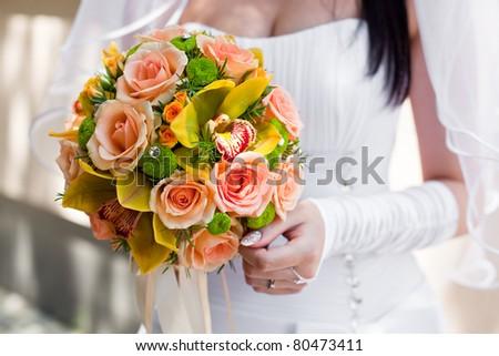 Bride with bouquet, closeup - stock photo