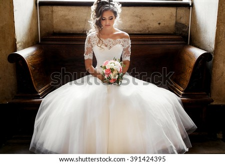 bride with bouquet in hand - stock photo