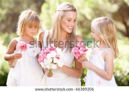 Bride With Bridesmaids Outdoors At Wedding - stock photo