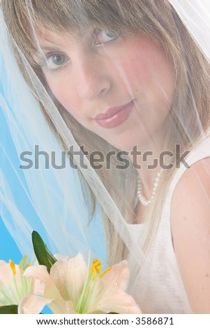 Bride with flowers on blue background - stock photo