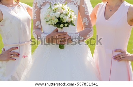 Bride with friends in the park