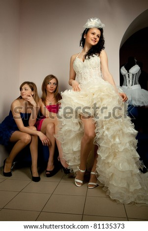 Bride with girlfriend in professional fashion designer studio