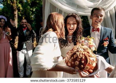 Bride with groom on wedding ceremony outdoors - stock photo