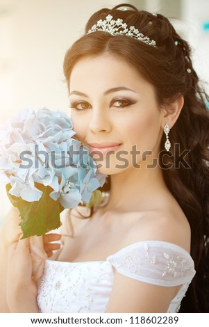 Bride with long hair outdoor - stock photo