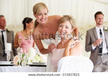 Bride With Mother At Wedding Reception - stock photo