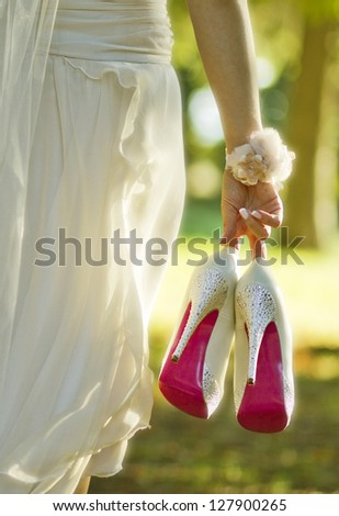 Bride with wedding shoes. Selective focus. - stock photo