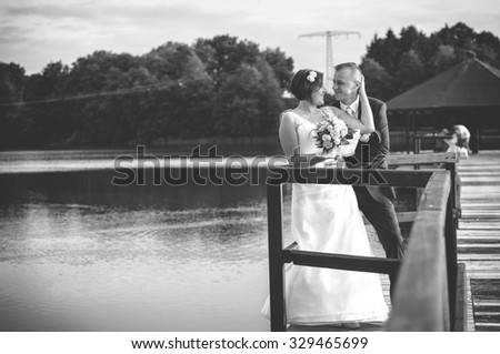bridegroom spending time at the lake on the pier