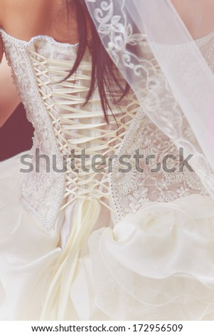 brides back in wedding white dress with lace - stock photo