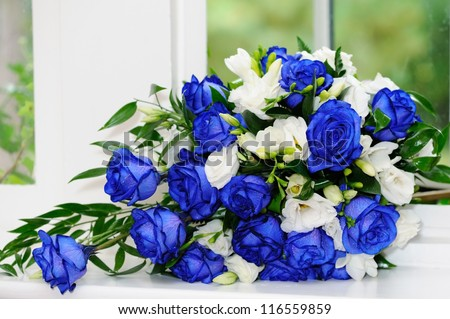Brides bouquet of blue and white roses - stock photo