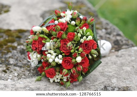 Brides bouquet of red and white roses before wedding - stock photo