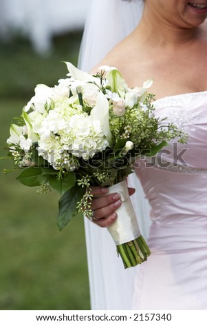 brides bouquet of wedding flowers, held in her hand