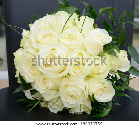 Brides bouquet of yellow roses closeup detail - stock photo