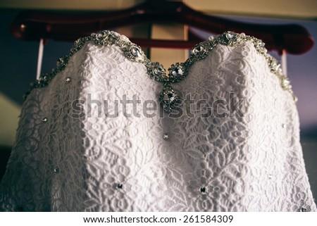 bridesmaid dress hanging in the closet - stock photo