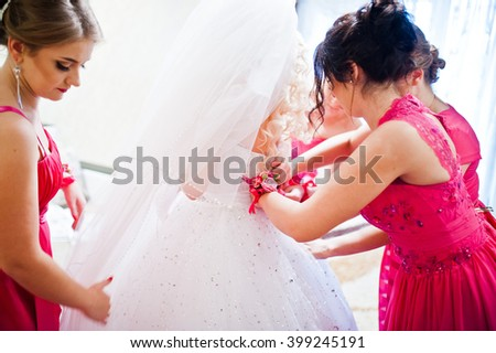 Bridesmaid dress wedding dress on bride - stock photo
