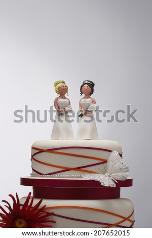 Bridesmaid Figurines on Wedding Cake - stock photo