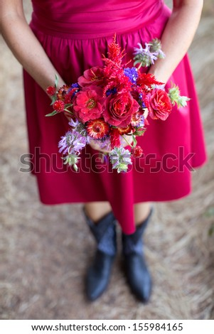 Bridesmaid Holding a Bouquet of Flowers - stock photo