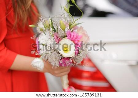 bridesmaid holding beautiful wedding bouquet  - stock photo
