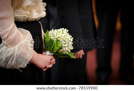 Bridesmaid holing lily of the valley - stock photo