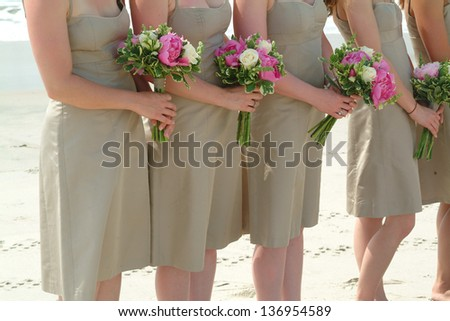 Bridesmaid on the beach waiting on the bride - stock photo
