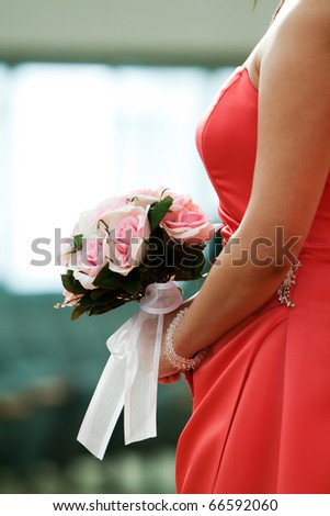 Bridesmaid's bouquet of flowers in wedding - stock photo