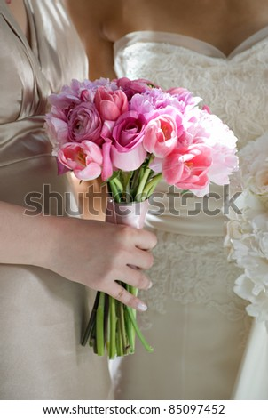 Bridesmaid with her Flower Bouquet - stock photo
