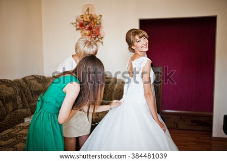 Bridesmaid with mother bride wear dress of bride - stock photo
