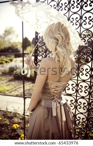 Bridesmaid with Parasol - stock photo