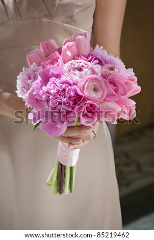 Bridesmaid with pink wedding flowers - stock photo