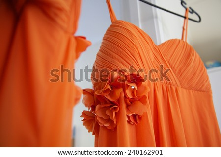 Bridesmaids dresses hanging. - stock photo