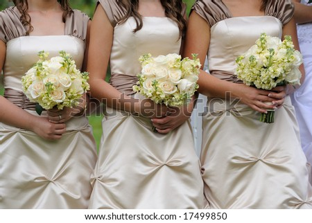 Bridesmaids have control over bouquets - stock photo