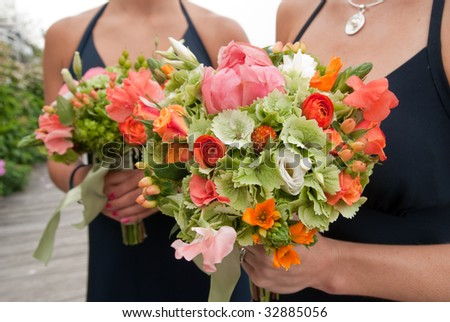 bridesmaids holding wedding bouquets - stock photo