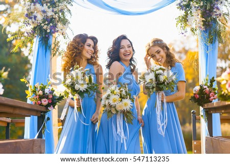 Bridesmaids in park on the wedding day