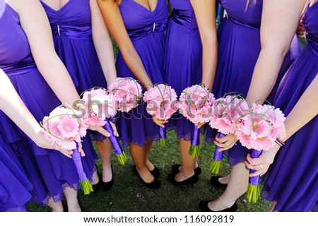 Bridesmaids pink flowers at wedding - stock photo