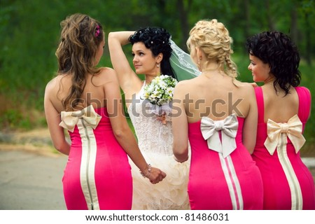 Bridesmaids standing with bride - stock photo