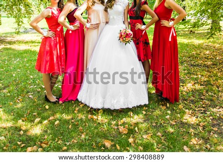 bridesmaids with bride,  girlfriends in colorful dresses - stock photo