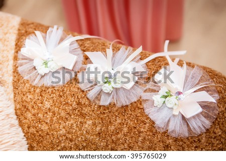 bridesmaids with wedding bouquet of flowers at bridal ceremony - stock photo