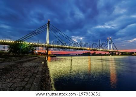 Bridge across river Sava at night with artificial lightning, Belgrade Serbia - stock photo