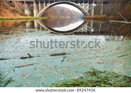 bridge across stream - stock photo
