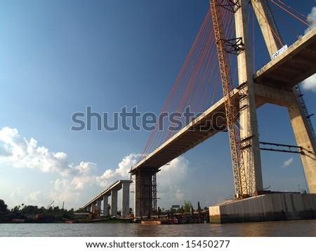 bridge across the mekong river - stock photo