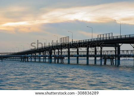Bridge across the sea and sunset scene.