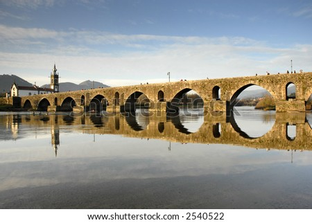 bridge and church of Ponte de Lima em Portugal - stock photo